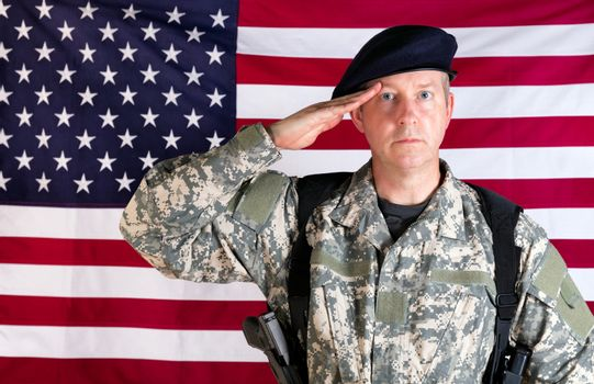 Veteran solider saluting with USA flag in background while armed