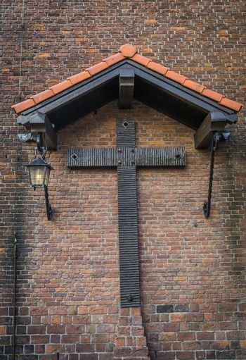old medieval style christian cross under a shed