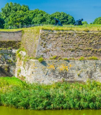 massive old stone defense wall with cannons