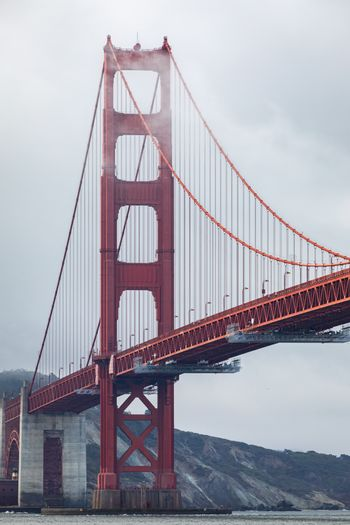 Golden gate bridge covered by cloud and fog on overcast day, San Francisco, California, USA.