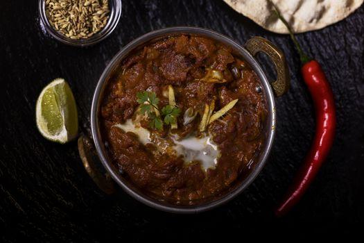 indian chicken tikka massala on slate