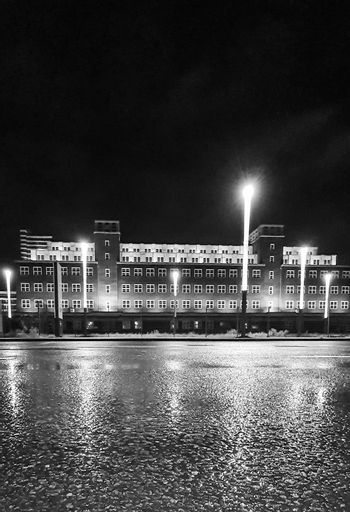 Black and white night shot of the central depot of the LVR Industrial Museum, Peter-Behrens-Bau, in Oberhausen, Germany. Bauhaus and the New Objectivity architecture style.