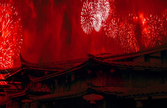 China concept chinese new year celebration background with chinese rooftops and fireworks with red smoke