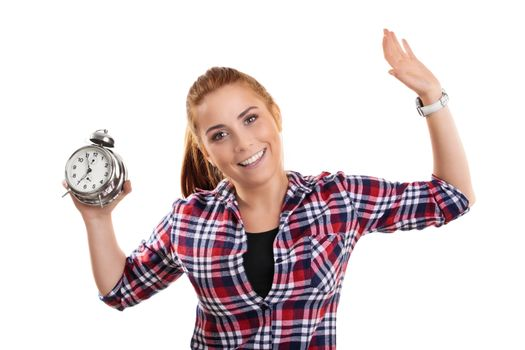 Time concept. Beautiful smiling young girl in casual clothes holding an old fashioned alarm clock with raised arms, isolated on white background.