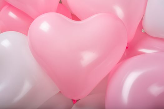 Happy valentines day greetings many heart shaped pink and white balloons background