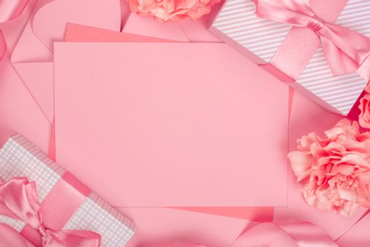 Valentines day pink background with blank love letter with copy space gift box and rose flowers