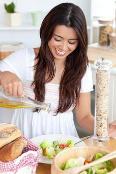 Attractive woman prepare a salad in the kitchen