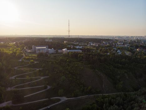 Aerial top vew of winding road in the city, drone shot