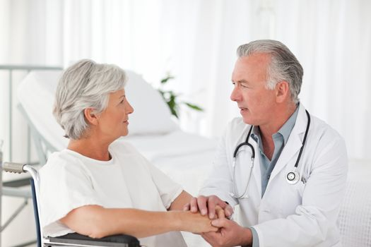 Doctor speaking with his patient