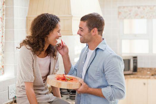 Man feeding his wife