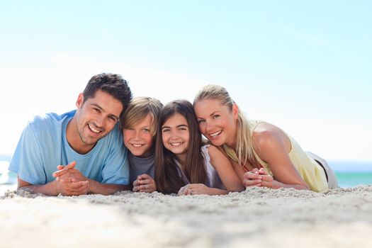 Children with their parents on the beach