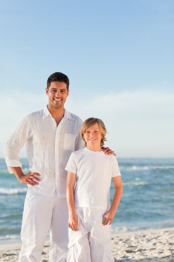 Father and his son against the sea