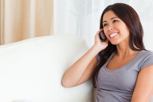 phoning woman on sofa
