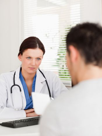 Female doctor and patient with prescription