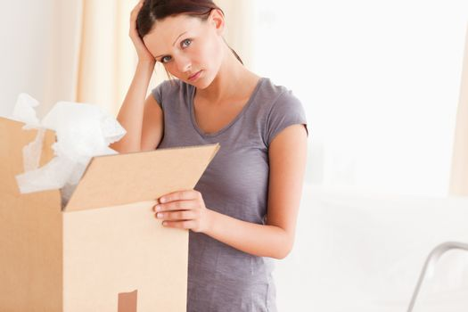 Woman with cardboard