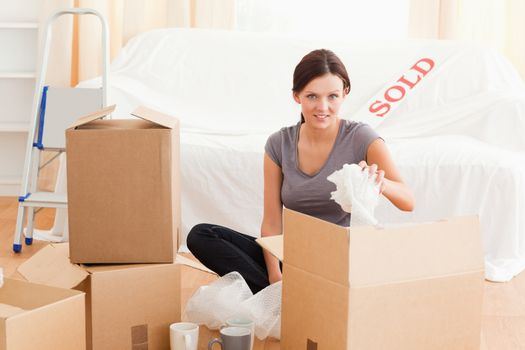 Charming woman packing her property