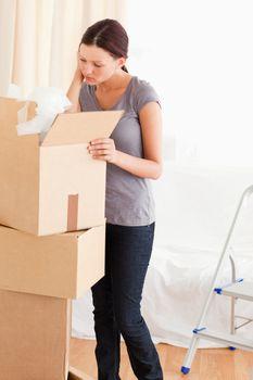 Woman searching in a cardboard