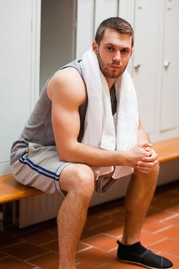 Portrait of a sports student sitting on a bench