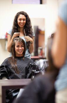Portrait of a woman making a haircut