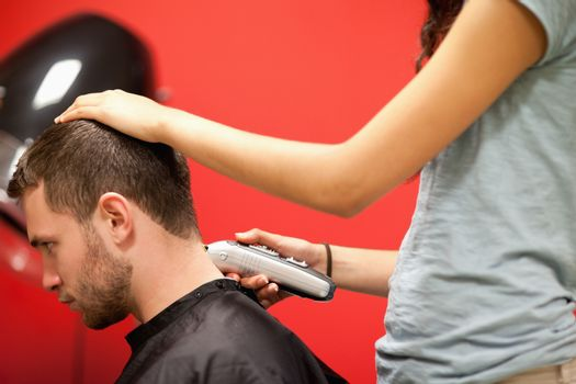 Male student having a haircut