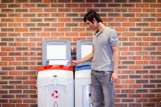 Young man recycling