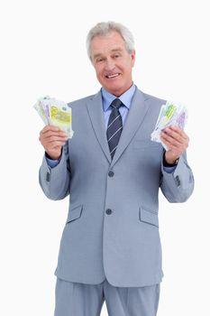 Mature businessman presenting his earnings