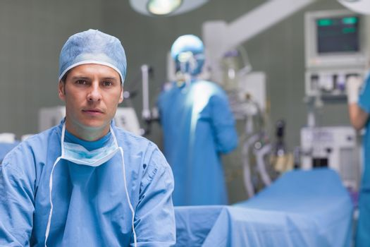 Practitioner next to operating table