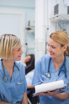 Smiling nurses speaking