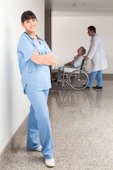 Proud nurse standing in the hallway