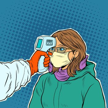 A doctor measures the temperature of a woman in a medical mask. Novel Wuhan coronavirus 2019-nCoV epidemic outbreak