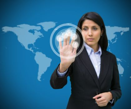 Businesswoman touching holographic screen against blue background