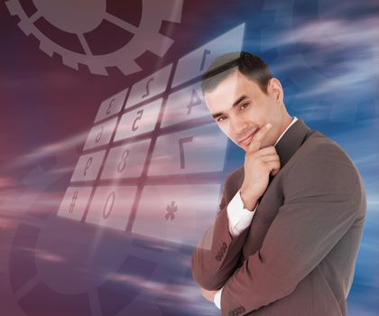 Businessman standing smiling with holographic number pad