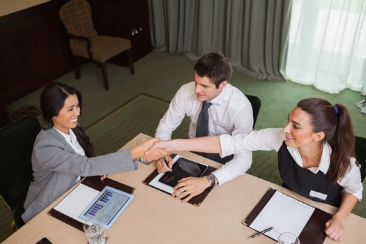 Businesswomen reaching agreement