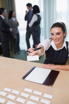 Woman handing you a name tag
