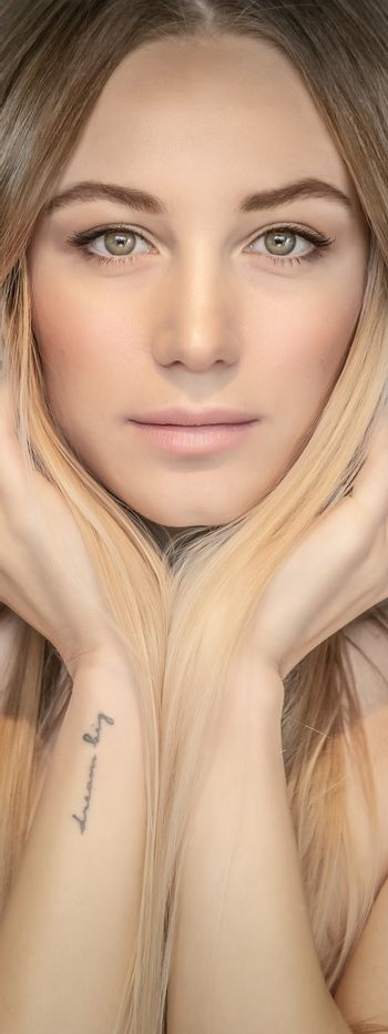 Authentic portrait of a beautiful blond woman, genuine beauty of a young adult female, natural makeup and fashion look