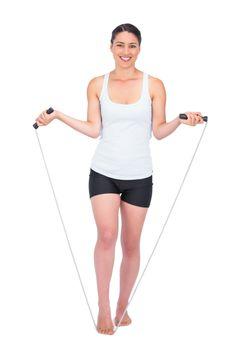 Smiling slender model jumping rope