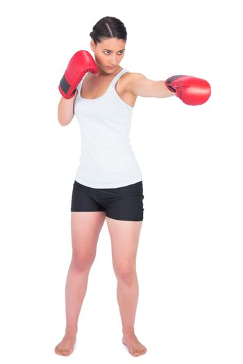 Slender model with boxing gloves punching