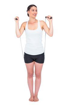 Cheerful slender model jumping rope