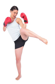 Slender model with boxing gloves kicking