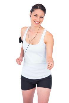 Smiling slender model jogging