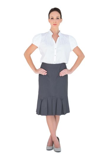 Unsmiling attractive businesswoman posing