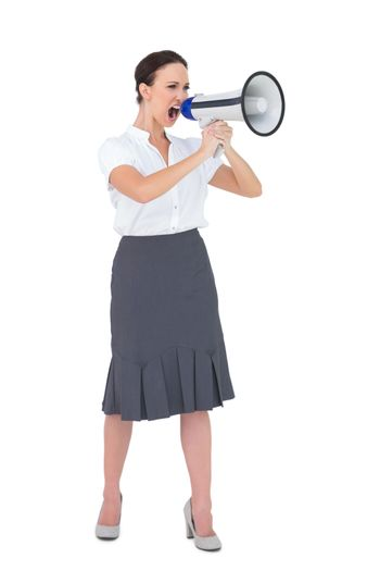 Furious businesswoman shouting in her megaphone