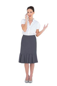 Irritated stylish businesswoman on the phone