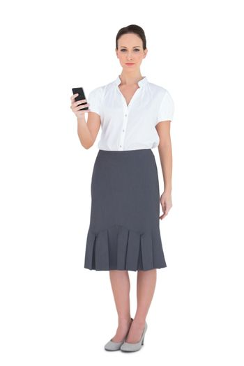 Content businesswoman holding her phone