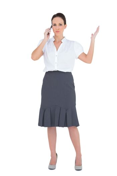 Furious businesswoman having a phone call