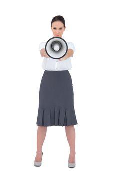 Stern businesswoman holding her megaphone