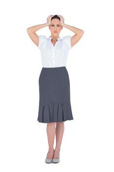 Anxious elegant businesswoman posing