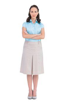 Unsmiling stylish businesswoman posing