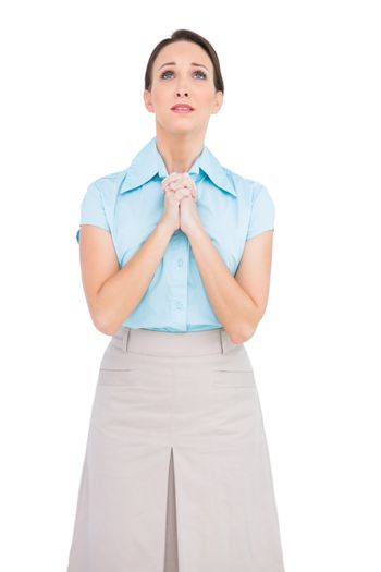 Troubled young businesswoman praying