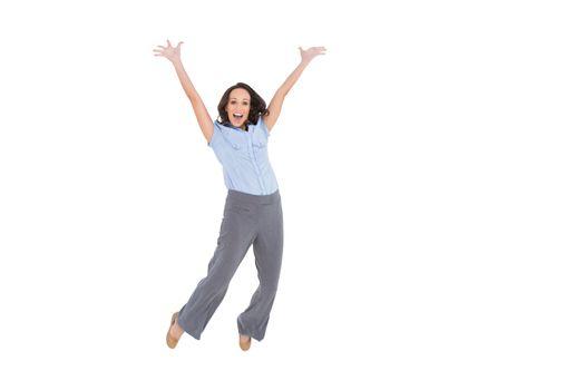 Cheerful classy businesswoman jumping